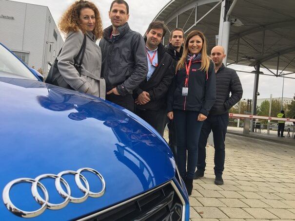 Melior Laser team with an  Audi TT Coupé at the Welcome center of Audi