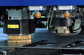 Combined punch-laser sheet metal processing machine